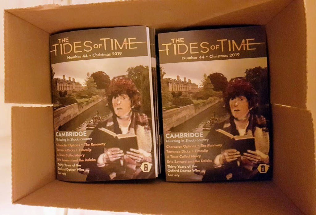 Printed copies of The Tides of Time issue 44, in a cardboard box.